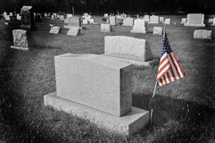 American flag by tombstone Stock Photography