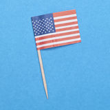 American Flag Toothpick on a Blue Background. Stock Photo