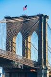 American flag on top of Brooklyn Bridge New York Stock Images