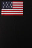 American Flag Top Left. American Flag at top left of image with a black background royalty free stock photos