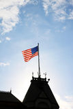 American flag. The american flag at he top of the roof Stock Images