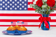 American flag, two glasses of champagne and cupcakes. Beautiful bouquet with american flag and cute cupcakes Royalty Free Stock Photo