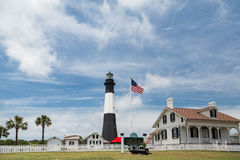American Flag and Tybee Lighthouse Royalty Free Stock Images