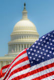 American Flag at U.S. Capitol. The american flag in front of the U.S. Capitol building stock photos