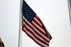 American flag. United states flag blowing in the wind against an overcast sky Stock Photo