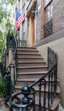American Flag up Steps. An American flag on a traditional house porch in Savannah Royalty Free Stock Photo