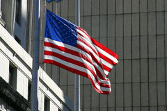 American Flag in Urban Setting. American Flag Iflying outside anofficial looking building that might be a government office or financial institution stock photo