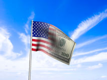 American flag us dollar over blue sky concept Royalty Free Stock Photography