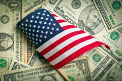 American flag with us dollars. Top view american flag on us dollars background stock images