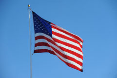 American Flag USA. An American flag flapping boldly in the wind Royalty Free Stock Photography