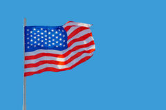 American flag. USA flag is waving in front of blue sky Royalty Free Stock Photography
