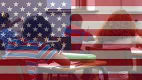 American flag video. Children studying at school at desks against animated american flag background stock video footage