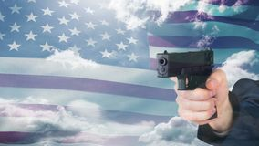 American flag video. Hand holding gun against animated american flag background stock footage