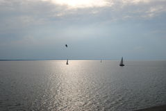 Sailboats out in open water. View from the deck of a  ferry three sailboats catching the wind Stock Photography