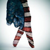 American flag walking. A man hand with its fingers painted as american flag simulating someone walking Stock Photography