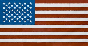 American flag on wall. American flag - large flag in grunge look as painted on a wall Stock Image