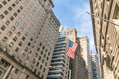 American Flag at Wall Street - New York financial District Royalty Free Stock Photography