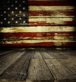American flag on wall. Wooden floor and American flag on wall Stock Photo