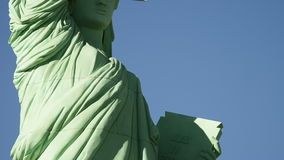 American flag waves in the foreground of statue of liberty. American flag at the backround of statue of liberty stock footage