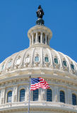 The American Flag waves in fron of the Capitol building in Washi Stock Image