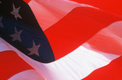 American Flag waving. Close-up of American flag blowing in the wind Royalty Free Stock Photo