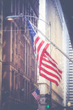 American flag waving in the breeze in the Chicago downtown loop Stock Photo