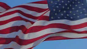American flag waving. Close-up of an American flag flying in the wind against a background of clear sky. American Flag Waving. Close up of American flag waving stock video