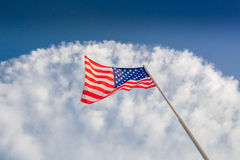 American flag waving with cloudy blue sky. Focus on star of waving flag Stock Photos