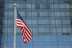 American Flag Waving in the downtown of a major city stock images