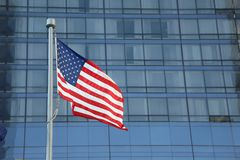 American Flag Waving in the downtown of a major city royalty free stock photo