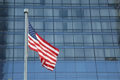 American Flag Waving in the downtown of a major city stock photo
