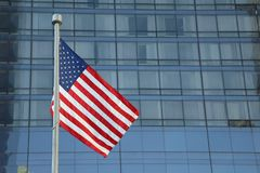 American Flag Waving in the downtown of a major city stock photos