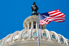 The american flag waving in front of the Capitol dome in Washing Royalty Free Stock Photography