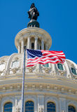 The american flag waving in front of the Capitol dome in Washing Royalty Free Stock Image