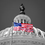 American flag waving in front of the Capitol in Washington D.C. Stock Images
