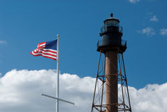 American Flag Waving By Marblehead Lighthouse in Massachusetts royalty free stock images