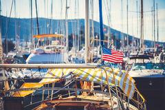 American flag waving from a sailboat Royalty Free Stock Photography