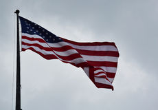 American flag waving in a sky Stock Images