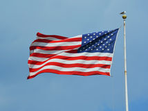 American flag waving in a sky Royalty Free Stock Photo