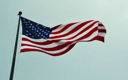 American flag waving in a sky Stock Photo
