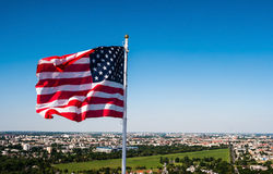 American flag waving in the sky Royalty Free Stock Images
