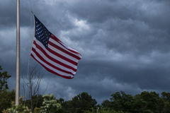 American Flag Waving with Storm Clouds Royalty Free Stock Images