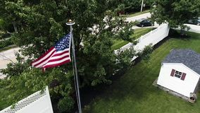 American Flag waving in the wind in 4K by Drone stock video footage