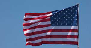 American flag waving in the wind, slow motion stock video footage