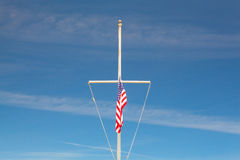 American flag waving in the wind on the typical American flagpol Royalty Free Stock Photography
