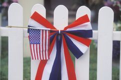 American Flag on White Picket Fence, Independence Day Parade, Cayucos, California Stock Image