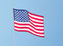 American flag in the wind against a sky Royalty Free Stock Photography