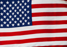 American flag in the wind against sky Royalty Free Stock Photos