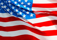 American flag in the wind in sunshine Royalty Free Stock Image