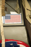 American flag on the windshield of a military vehicle Royalty Free Stock Images